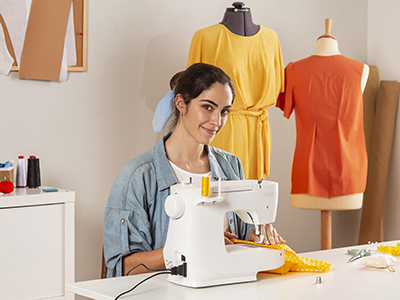 medium-shot-smiley-woman-sewing-with-machine