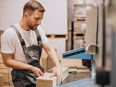 Young handsome man working at a factory
